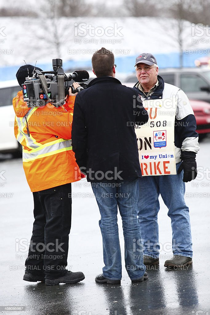 News Crew Interviewing Worker on Strike royalty-free stock photo