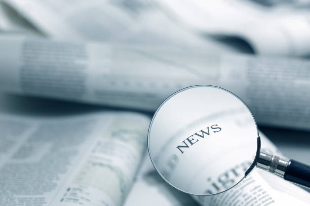 news headlines Use magnifier to search for news headlines newspaper cutouts of bad news headlines stock pictures, royalty-free photos & images