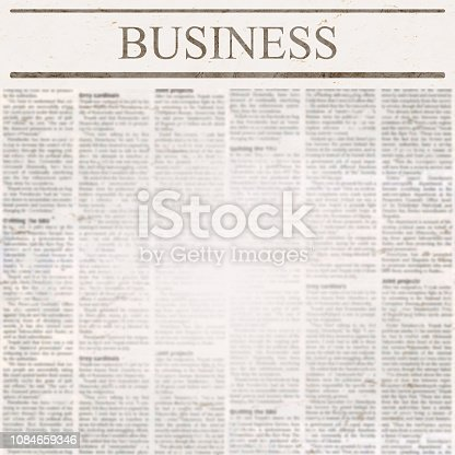 istock News newspaper with headline Business and old unreadable text 1084659346