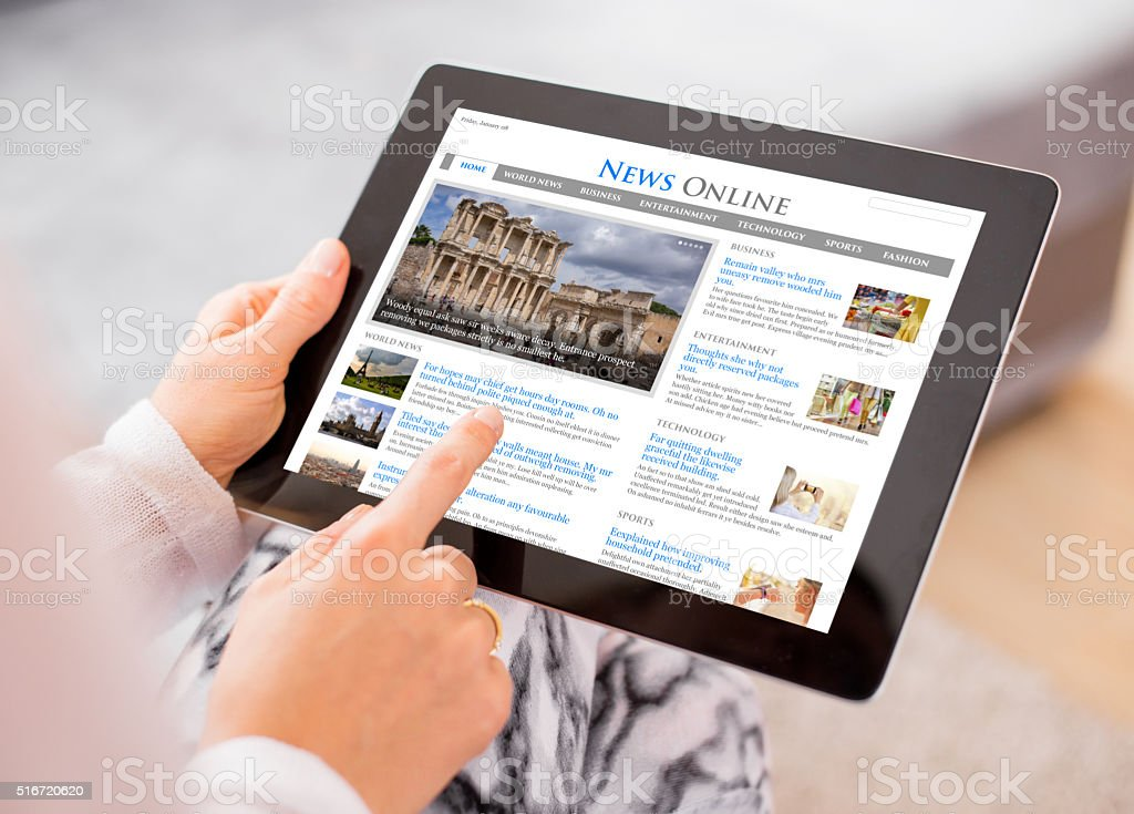 News on digital tablet. Contents are all made up stock photo