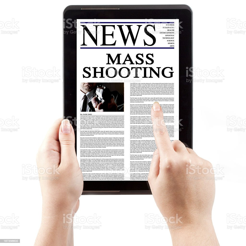 News on Tablet Computer - Mass Shooting stock photo