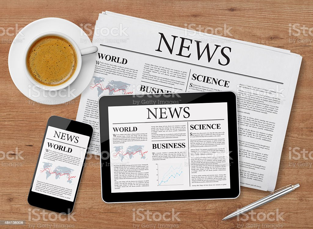 News page on tablet, mobile phone and newspaper stock photo