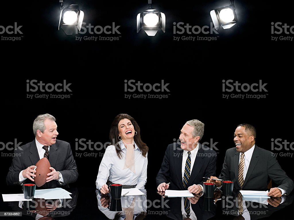 News presenters laughing stock photo