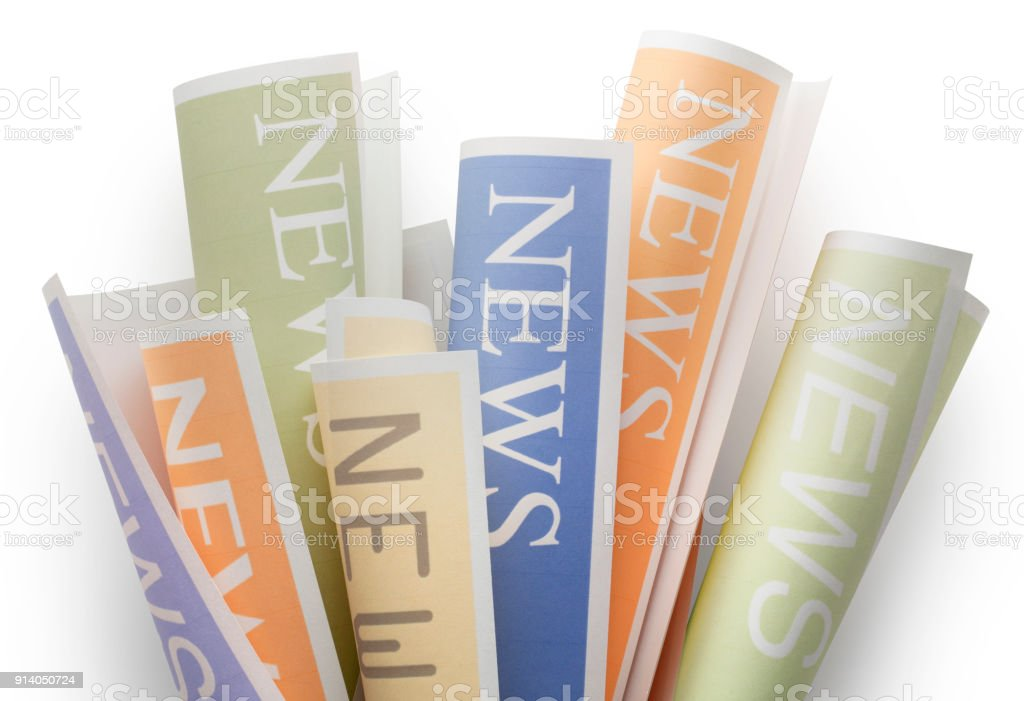 News. Rolls of newspapers on white background. stock photo