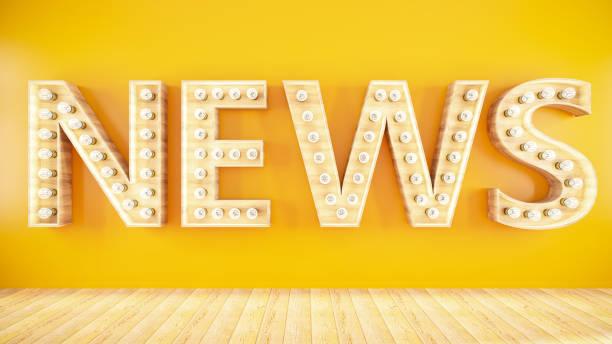 News Sign on Yellow Wall stock photo
