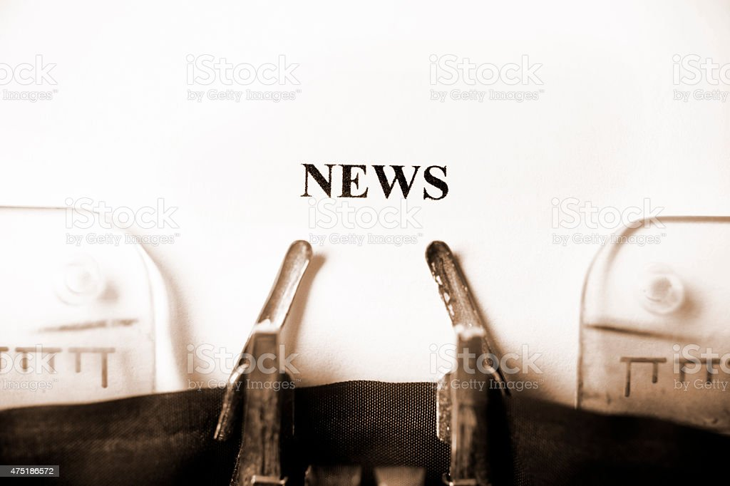 News typed on a typewriter. News headline. Press release. stock photo