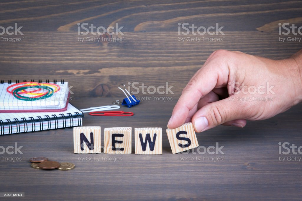 News. Wooden letters on dark background stock photo