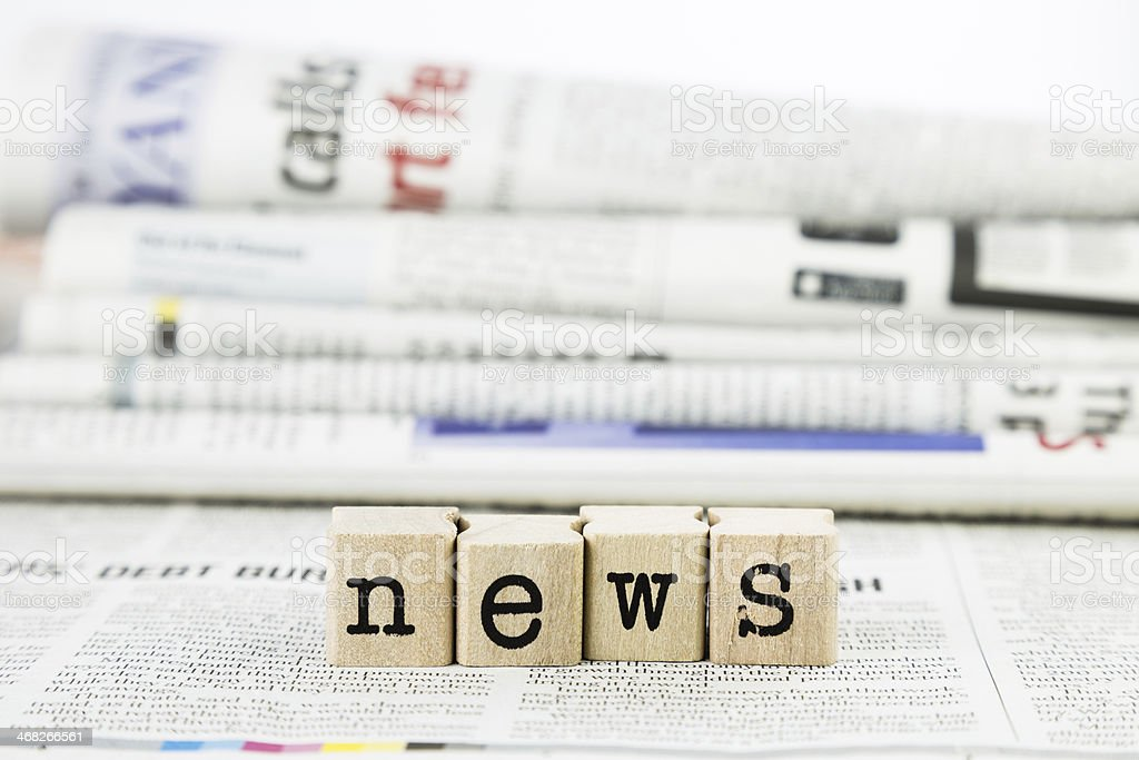 News wording on newspaper background stock photo