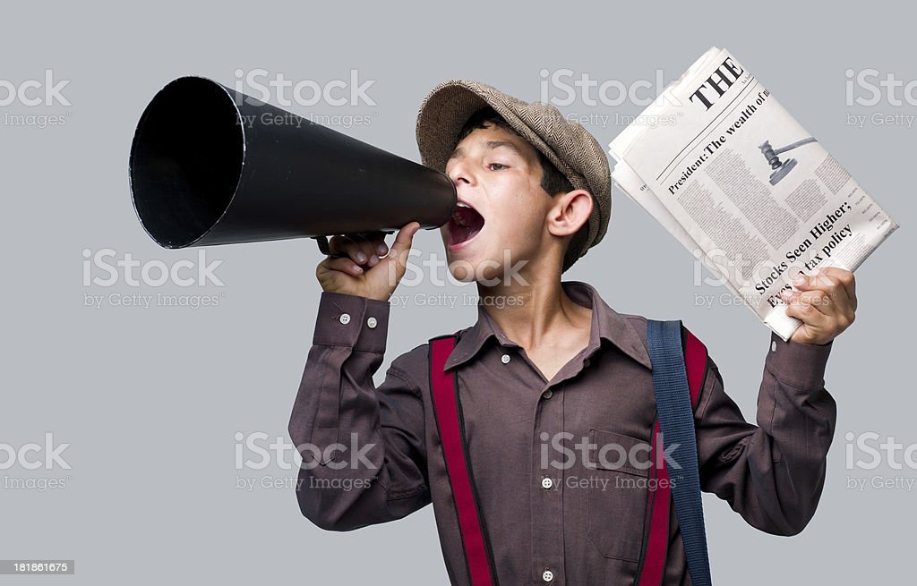 Newsboy holding newspaper and shouting to sell royalty-free stock photo