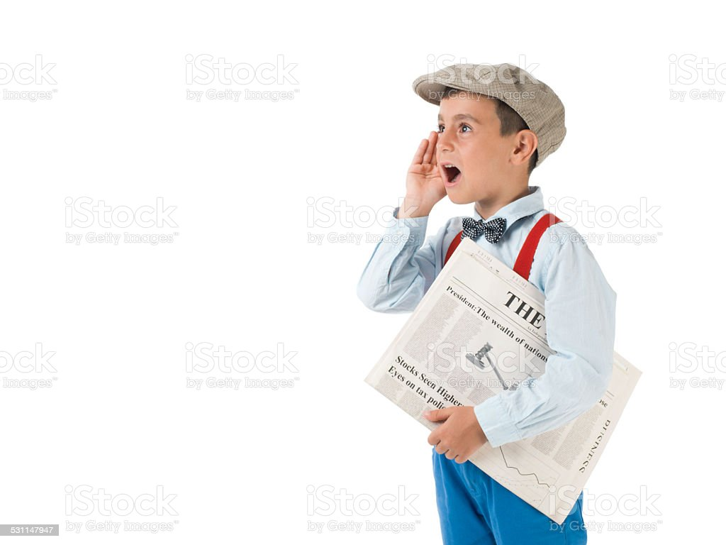Newsboy holding paper and shouting stock photo