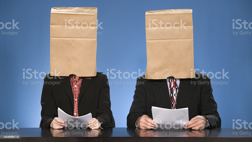 Newscasters blinded by bags. stock photo