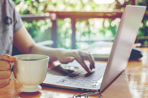 newsletter concept Hand of businesswoman holding cup of coffee and checking message box on digital laptop, blank black space for your text newsletter concept Hand of businesswoman holding cup of coffee and checking message box on digital laptop, blank black space for your text newsletter stock pictures, royalty-free photos & images