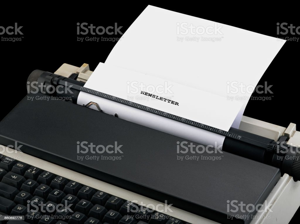 Newsletter message typed by vintage typewriter. stock photo