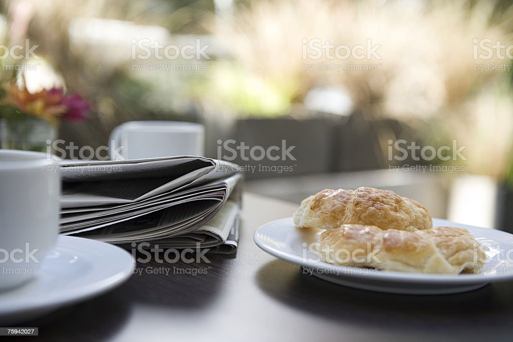Newspaper and breakfast royalty-free stock photo