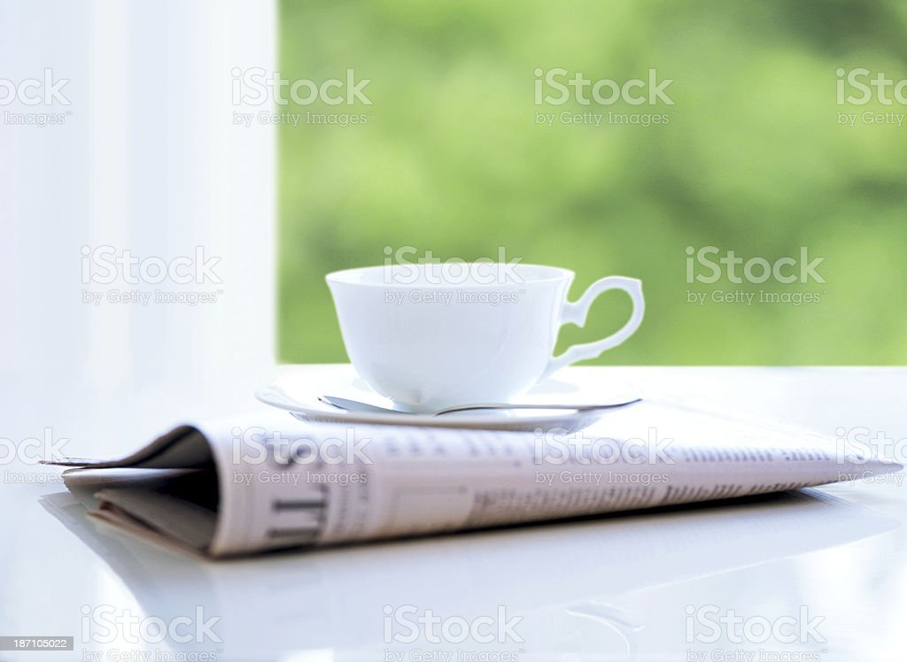 newspaper and coffee cup stock photo