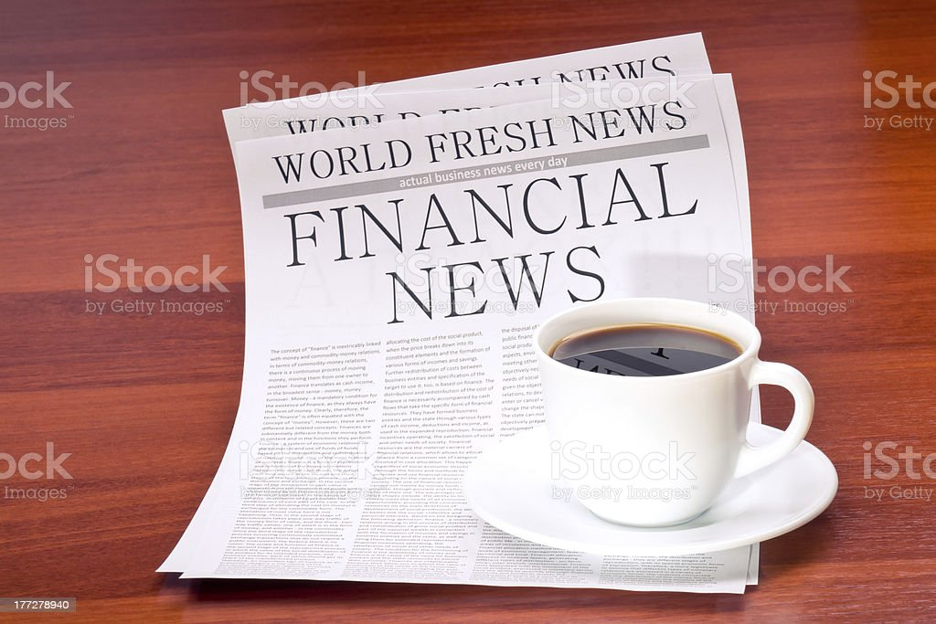 Newspaper and cup of coffee royalty-free stock photo