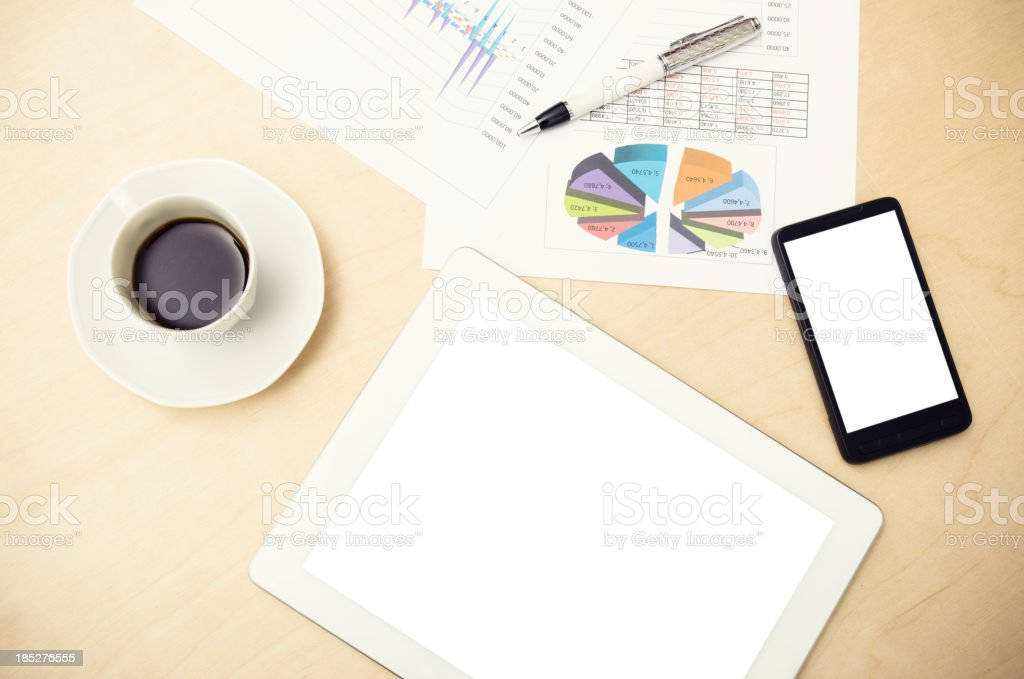 Newspaper and financial data with modern device royalty-free stock photo