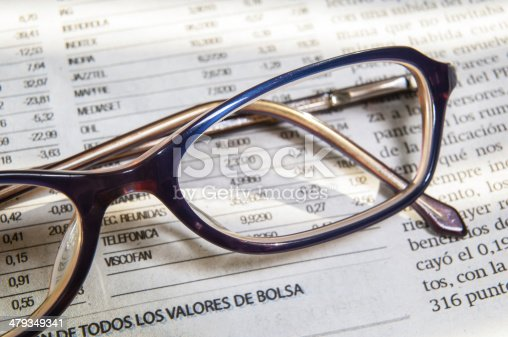 istock newspaper and glasses 2 479349341