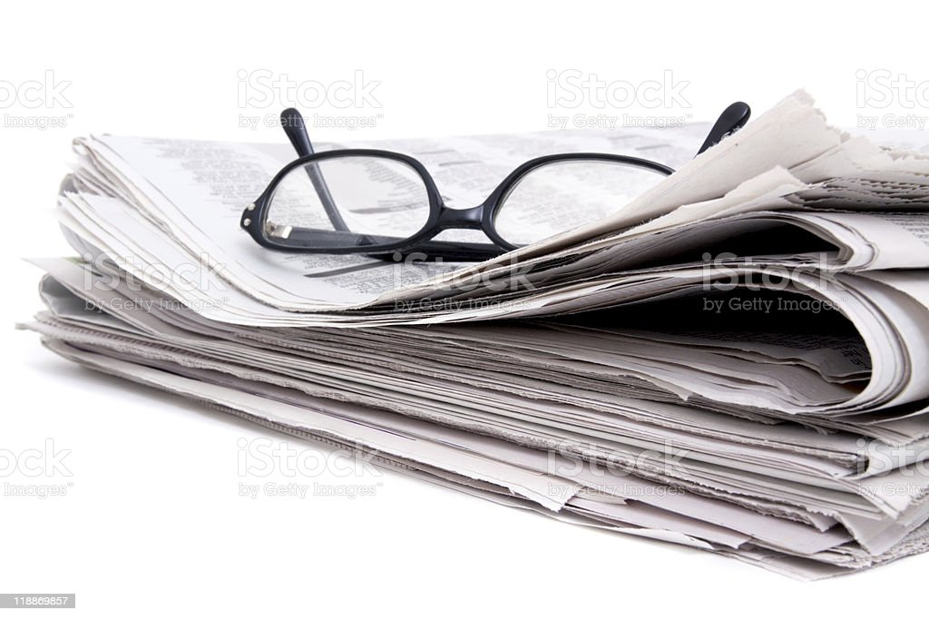 Newspaper and glasses royalty-free stock photo