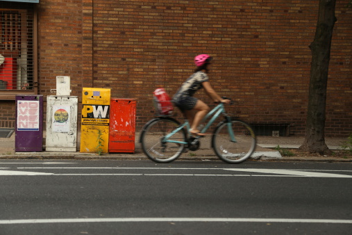 Newspaper box and Bicycle Woman