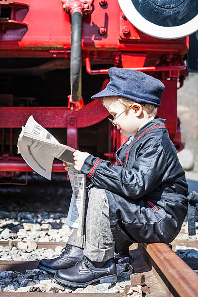 newspaper break - transport conductor stock photos and pictures