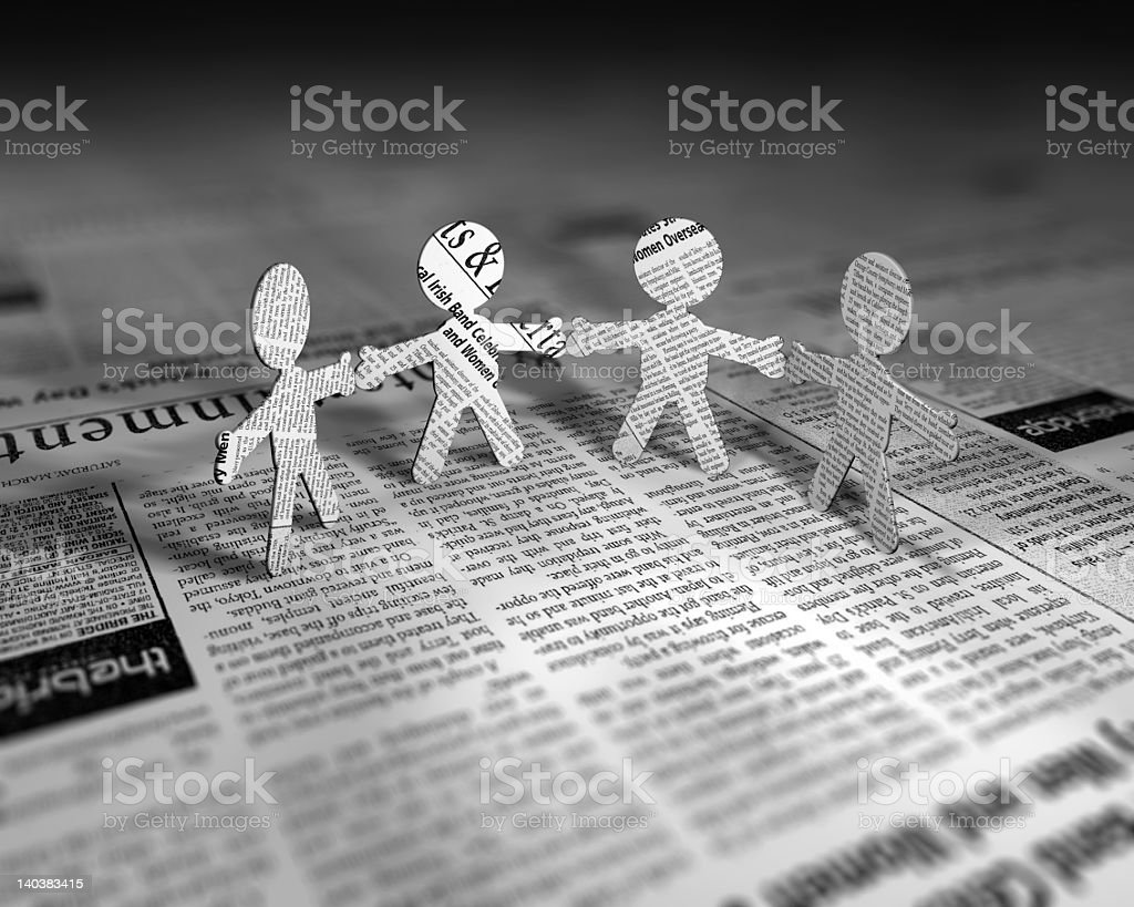 Newspaper Chain family standing on newspaper royalty-free stock photo