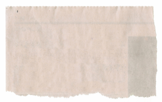 A torn piece of newspaper for background.