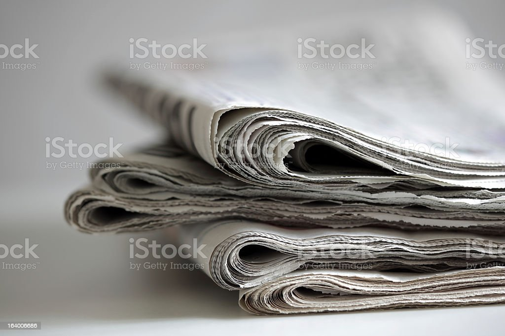Newspaper edges with white background stock photo