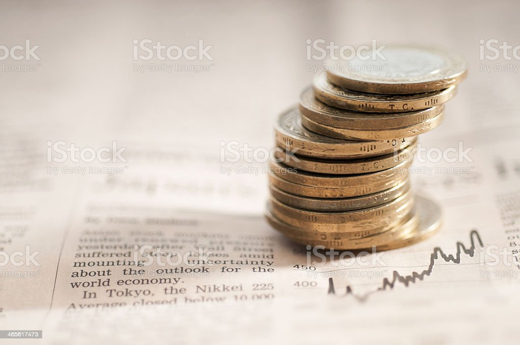 Newspaper financial section with coins royalty-free stock photo