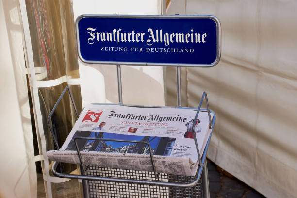 """Newspaper """"Frankfurt Allgemeine Zeitung"""" in a paper holder Frankfurt, Germany - September 30, 2018: Frankfurter Allgemeine Zeitung paper holder. Frankfurt General Newspaper, abbreviated FAZ, is a centre-right, liberal-conservative daily German newspaper magazine rack stock pictures, royalty-free photos & images"""