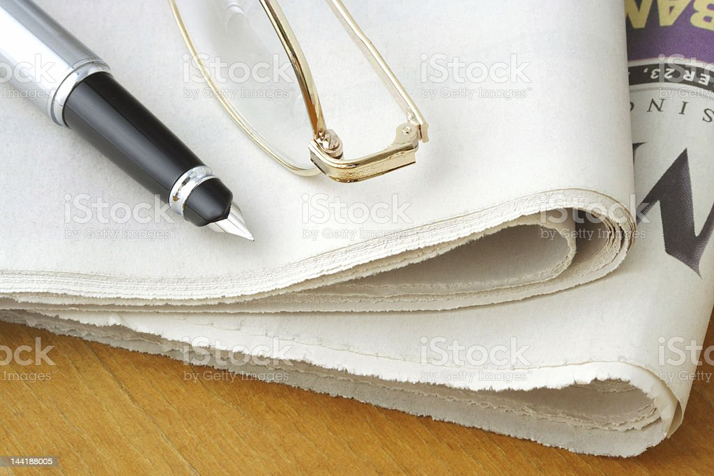 Newspaper, Glasses and Pen royalty-free stock photo