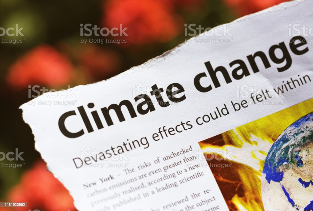 Newspaper headline and report warn of worsening climate change as the planet warms Dummy newspaper cutting sound the alarm on global warming. Accidents and Disasters Stock Photo
