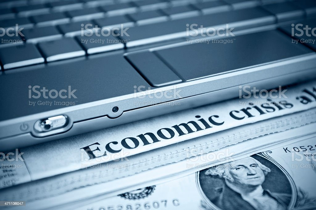 Newspaper headline. Economic Crises. Toned image with laptop. royalty-free stock photo