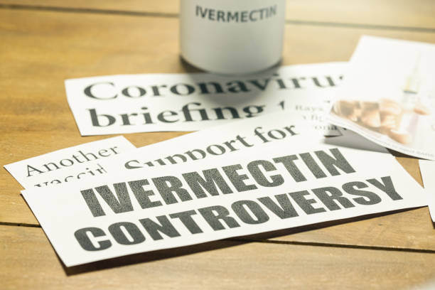 Newspaper headlines about ivermectin, a medicine being controversially proposed to treat Covid-19 in the pandemic Ivermectin is not a brand name: it is the generic term for the drug. ivermectin stock pictures, royalty-free photos & images