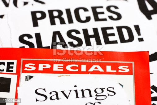 A large stack of newspaper cuttings, all dealing with slashed prices, savings and specials.