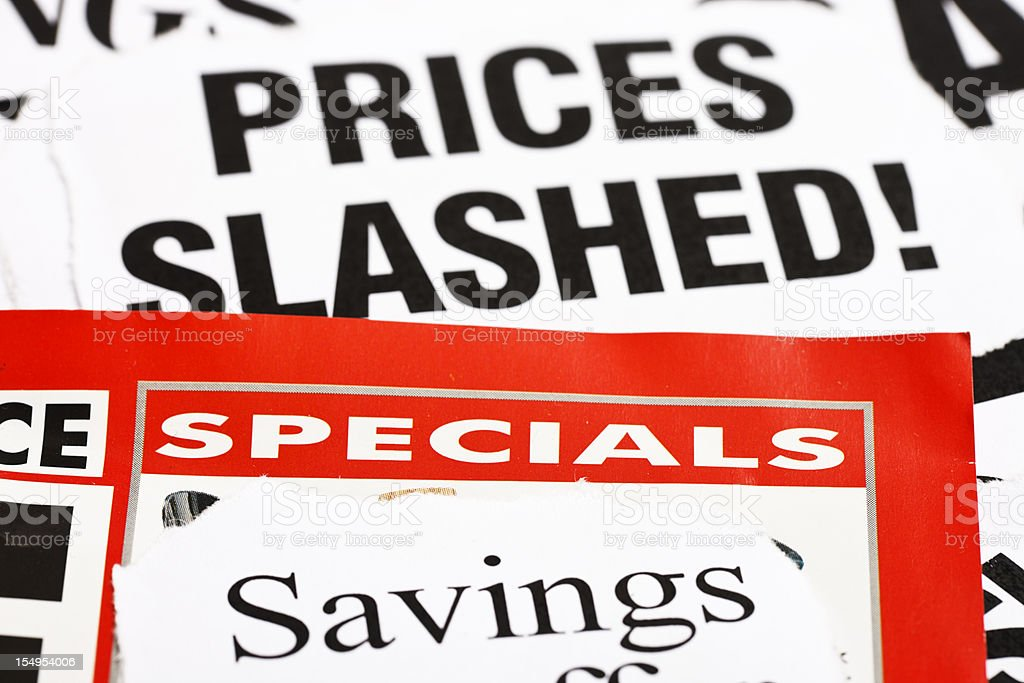 Newspaper headlines announce price cuts stock photo