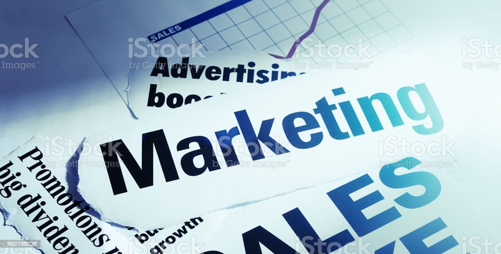 Newspaper Headlines On Marketing And Advertising Stock Photo ...