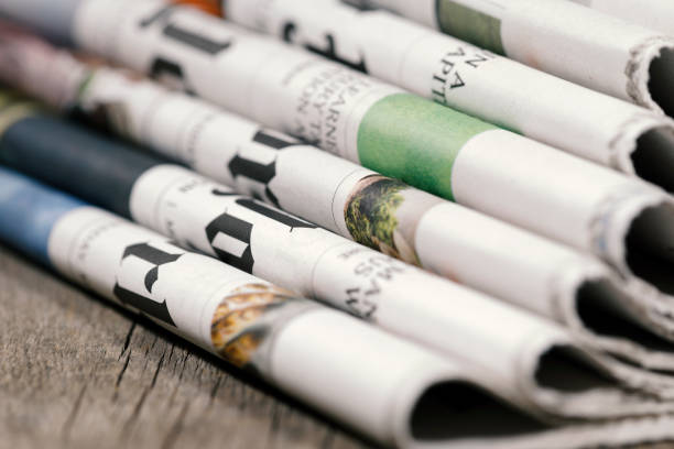 Newspaper headlines Stack of newspapers on wooden table article stock pictures, royalty-free photos & images