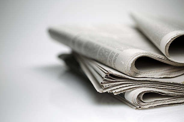 newspaper isolated on white background - stack rock stock pictures, royalty-free photos & images