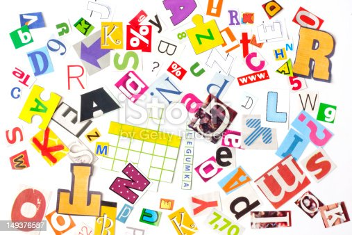 812461124istockphoto newspaper letters background 149376587