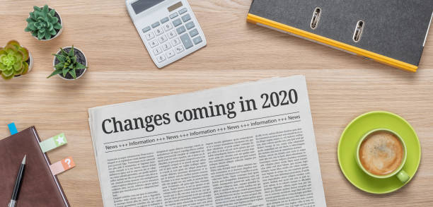 A newspaper on a desk with the headline Changes coming in 2020 A newspaper on a desk with the headline Changes coming in 2020 front page stock pictures, royalty-free photos & images