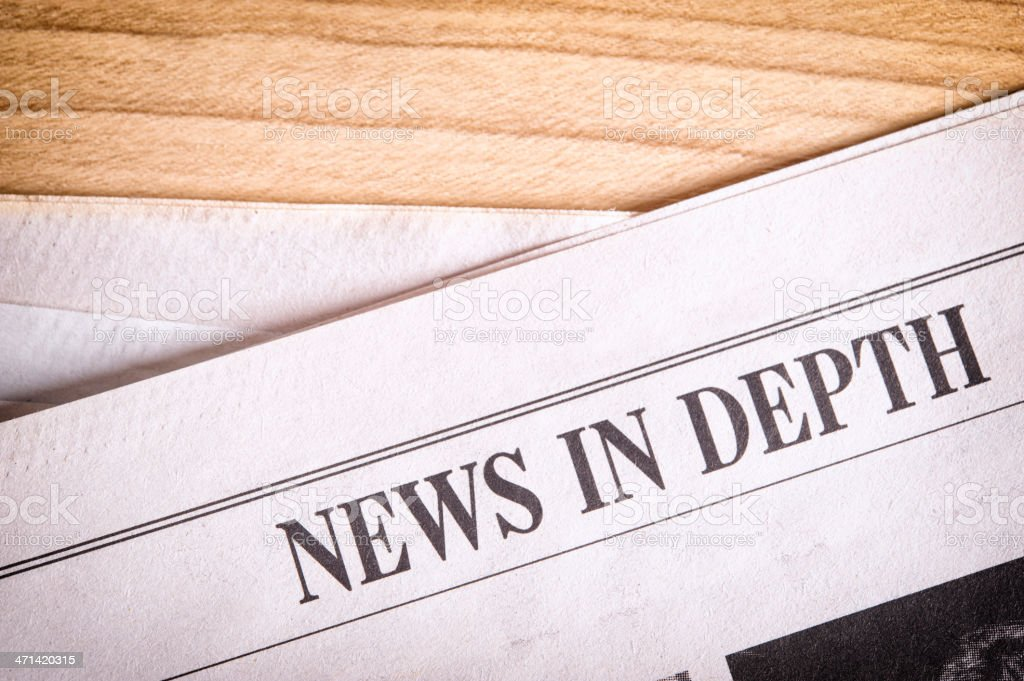 Newspaper on a table royalty-free stock photo