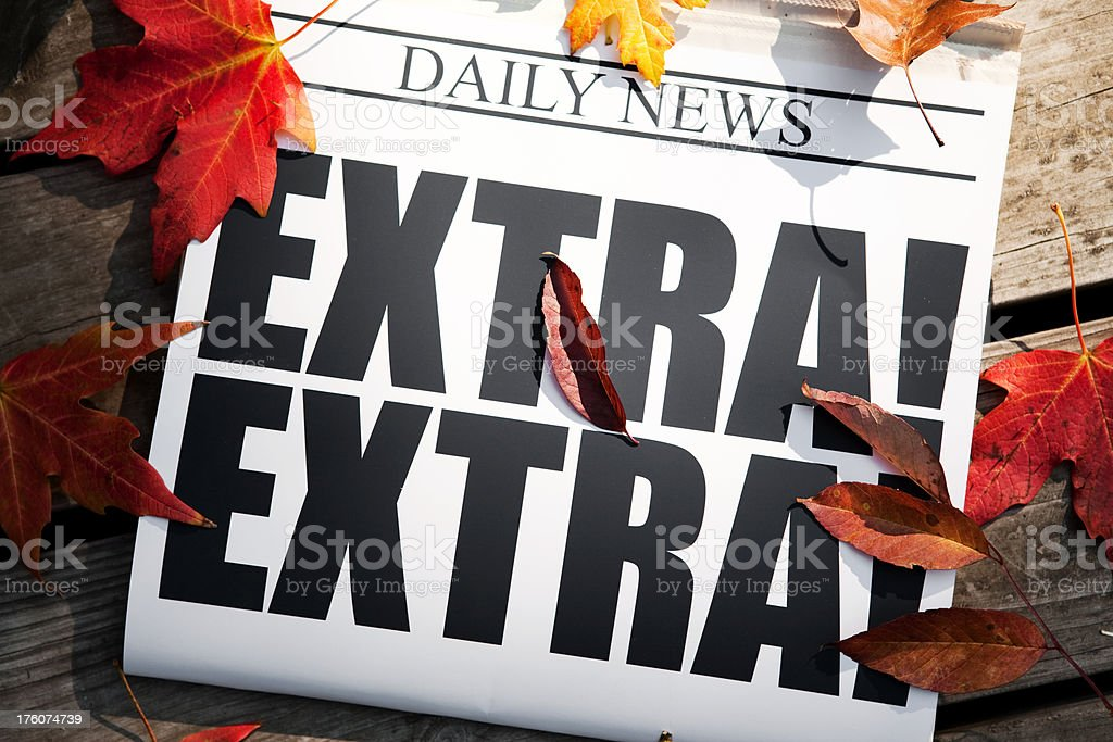EXTRA! Newspaper on Deck with Autumn Leaves royalty-free stock photo