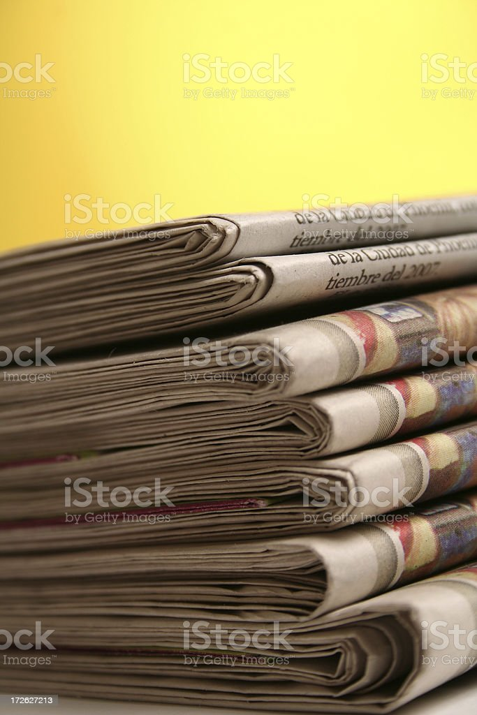 Newspaper on yellow background royalty-free stock photo