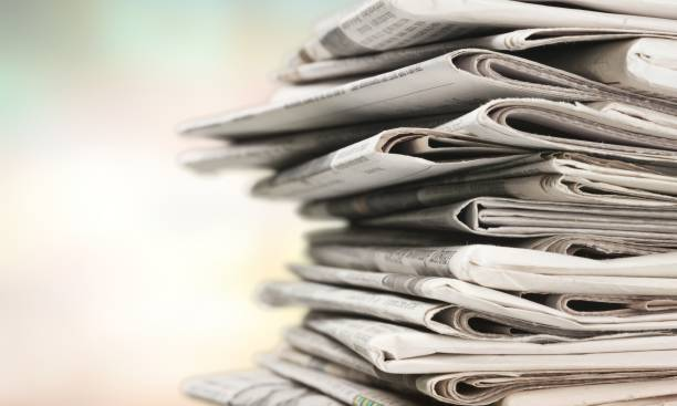 Newspaper. Pile of newspapers on white background paper stock pictures, royalty-free photos & images