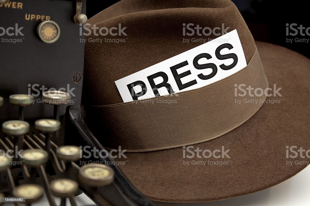 Newspaper Reporter's PressPass in Hat. stock photo
