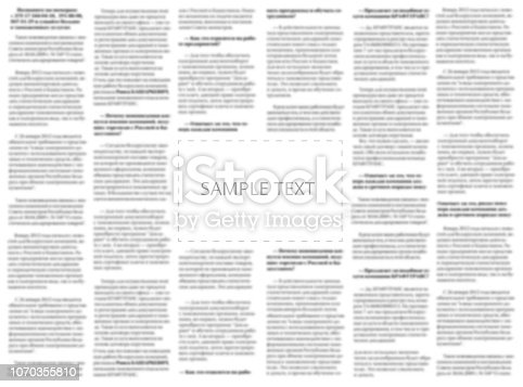 613303142 istock photo Newspaper sample with copy space for your text on the blurred columns background. Mockup for tabloid. Blurred text of paper columns with blank space for your news. Sample of black and white journal. 1070355810
