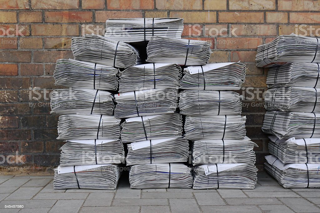 newspaper stack on street stock photo