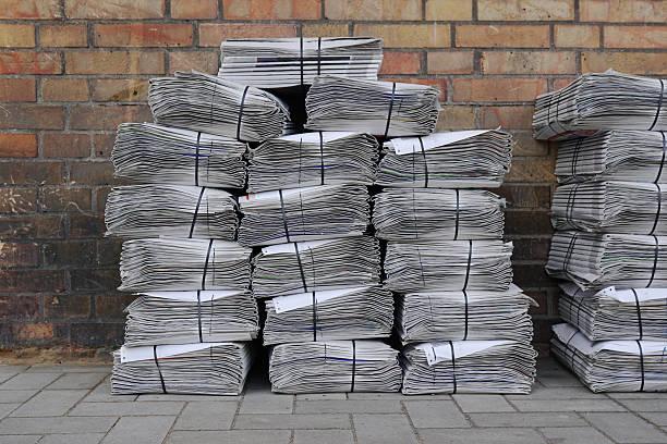 newspaper stack on street - Photo