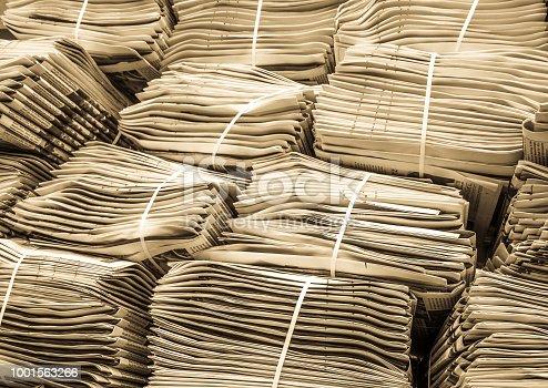 newspaper stacks at a sidewalk